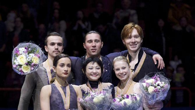 From left, pairs Ksenia Stolbova and Fedor Klimov, Yuko Kavaguti and Alexander Smirnov, Evgenia Tarasova and Vladimir Morozov, all of Russia, pose with their silver, gold and bronze medals during the awarding ceremony at the European Figure Skating championships in Stockholm, Sweden, on Sunday, Feb. 1, 2015. (AP Photo/Ivan Sekretarev)