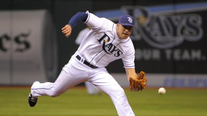 Tampa Bay Rays third baseman Evan Longoria comes up with Kansas City Royals Eric Hosmer's ground ball to make the play at first base for the out during the second inning of a baseball game Tuesday, Aug. 9, 2011, in St. Petersburg, Fla. (AP Photo/Brian Blanco)