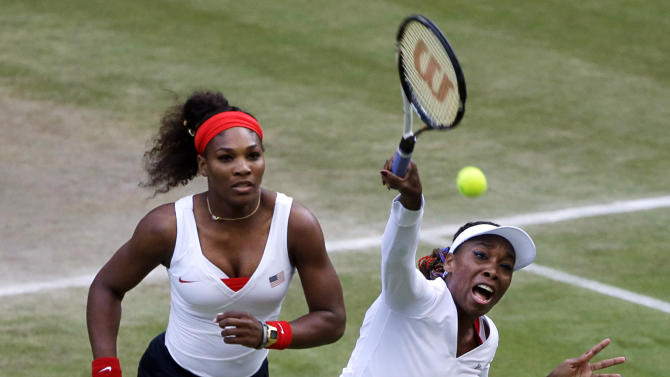 FILE - In this Aug. 4, 2012, file photo, Venus Williams, right, returns a shot as Serena Williams, left, watches during their women's doubles semifinal match against Maria Kirilenko and Nadia Petrova, of Russia, at the All England Lawn Tennis Club at Wimbledon in London at the 2012 Summer Olympics. Fans can look forward to a variety of grunts, shrieks and hoots as the start of the U.S. Open tennis tournament approaches on Monday, Aug. 27, in New York. Noisemaking competitors have stirred reactions from tennis enthusiasts and opposing competitors, causing governing bodies to look for ways to regulate the sound level. The Associated Press takes a look at offenders past and present, the hindrance rule, and how to tame the grunters. (AP Photo/Mark Humphrey, File)