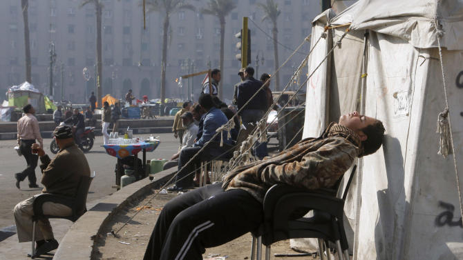 An Egyptian protester takes a nap outside his tent in Tahrir Square, the focal point of Egyptian uprising, in Cairo, Egypt, Saturday, Feb. 9, 2013. Egypt has witnessed a fresh cycle of violence over the past two weeks since the second anniversary of the 2011 uprising that deposed longtime autocrat Hosni Mubarak, with clashes across the country having left scores dead and hundreds injured. (AP Photo/Amr Nabil)