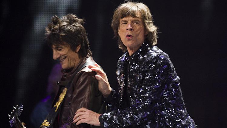 Ronnie Woods, left, and Mick Jagger of The Rolling Stones perform in concert on Saturday, Dec. 8, 2012 in New York. (Photo by Charles Sykes/Invision/AP)