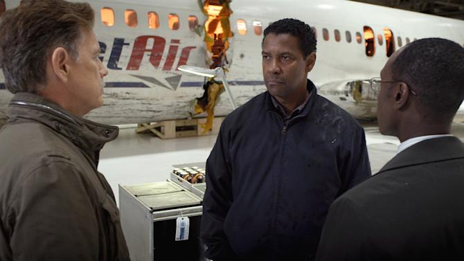 """This film image released by Paramount Pictures shows, from left, Bruce Greenwood as Charlie Anderson, Denzel Washington as Whip Whitaker and Don Cheadle as Hugh Lang in a scene from """"Flight."""" (AP Photo/Paramount Pictures)"""