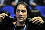 Former French international footballer Robert Pires, also formerly of Premier League team Arsenal, watches Rafael Nadal of Spain play against Jo-Wilfried Tsonga of France during their group B singles match in the round robin stage on day five of the ATP World Tour Finals tennis tournament in London on November 24, 2011. AFP PHOTO / GLYN KIRK