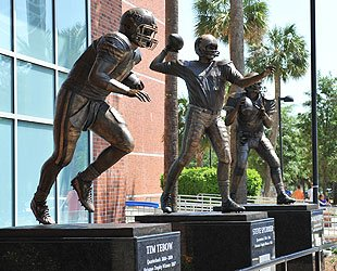 The statue of Spurrier outside Florida's stadium is between Tim Tebow's and Danny Wuerffel's. (Getty Images)