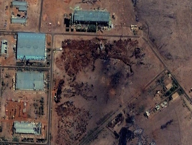 FILE -Part of the Yarmouk military complex in Khartoum, Sudan seen in a satellite image made on October 25 2012, following an alleged attack. A U.S. monitoring group says satellite images of the aftermath of an explosion at a Sudanese weapons factory suggest the site was hit by an airstrike. The Sudanese government has accused Israel of bombing its Yarmouk military complex on Oct 23, killing two people and leaving the factory in ruins. Analysts speculate that the 40 shipping containers which were destroyed in the central area of the image may have contained Iranian missiles bound for Gaza. (AP Photo/ DigitalGlobe via Satellite Sentinel Project, File)