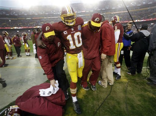 RG3 hurt, but Redskins top Ravens 31-28 in OT