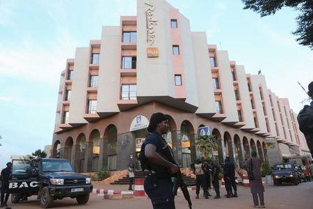 """Mali state TV shows photos of """"authors"""" of hotel attack"""