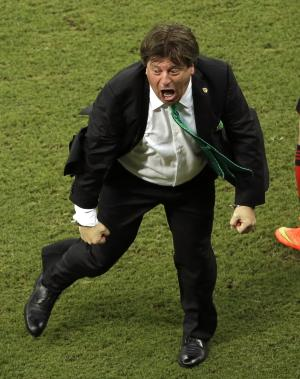 In this June 23, 2014 photo, Mexico's head coach Miguel Herrera celebrates after Mexico's Andres Guardado scored Mecico's side's second goal during the group A World Cup soccer match between Croatia and Mexico at the Arena Pernambuco in Recife, Brazil. Mexico's national soccer coach just can't keep his joy bottled up, and his enthusiasm has made him one of the most entertaining and popular figures of the World Cup and an Internet sensation worldwide. (AP Photo/Hassan Ammar)