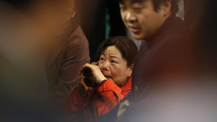 "A family member of a missing passenger on the South Korean ferry ""Sewol"" which sank at sea cries as she wait for news from a rescue team at a gym in Jindo"
