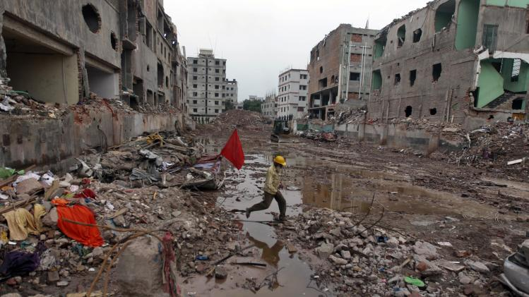 A Bangladeshi rescue worker walks at the site where a Bangladesh garment-factory building collapsed on April 24 in Savar, near Dhaka, Bangladesh, Monday, May 13, 2013. Nearly three weeks after the building collapsed, the search for the dead ended Monday at the site of the worst disaster in the history of the global garment industry.(AP Photo/A.M. Ahad)