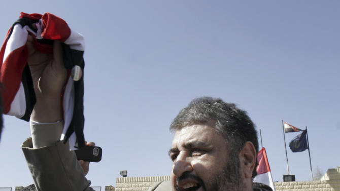 FILE - In this Thursday, March 3, 2011 file photo, Khayrat el-Shater, the lead strategist for Egypt's largest opposition group, waves by Egyptian flag after being released from Tora prison in Cairo, Egypt. Egypt's Muslim Brotherhood on Saturday said it decided to field the movement's deputy leader and top strategist as its presidential candidate, topping off its success in legislative elections with a bid for the country's most powerful post. Top leaders of the country's most influential political group announced in a press conference that it selected Khayrat el-Shater to contest the presidential race set to start in May. (AP Photo/Mohammed Abu Zaid, File)