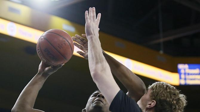 Utah's Dallin Bachynski, left, takes an elbow to the face from UCLA's Tony Parker during the first half of an NCAA college basketball game Thursday, Jan. 29, 2015, in Los Angeles. UCLA won 69-59. (AP Photo/Danny Moloshok)