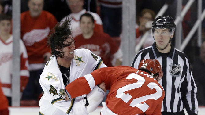 Dallas Stars defenseman Brenden Dillon (4) and Detroit Red Wings wing Jordin Tootoo (22) fight during the first period of an NHL hockey game in Detroit, Tuesday, Jan. 29, 2013. (AP Photo/Paul Sancya)
