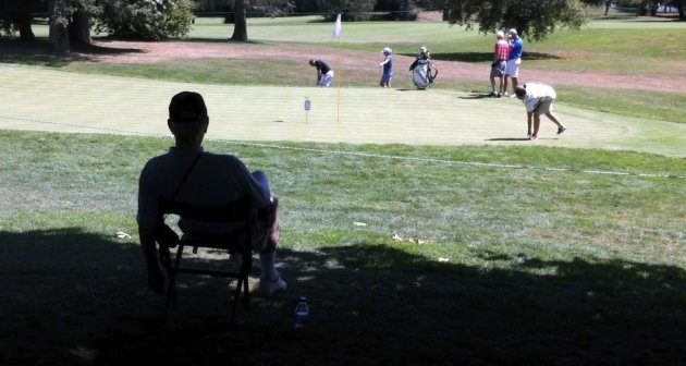 Phil Jones sits in the shade, with a view of the 11th green as the temperature rose into the 90s, during the pro-am of the LPGA Tour&#39;s Safeway Classic golf tournament at Pumpkin Ridge Golf Club in North Plains, Ore. (AP Photo/The Oregonian, Michael Lloyd) MAGS OUT, TV OUT, LOCAL TV AND INTERNET OUT, (THE MERCURY, WILLAMETTE WEEK, PAMPLIN MEDIA GROUP OUT)