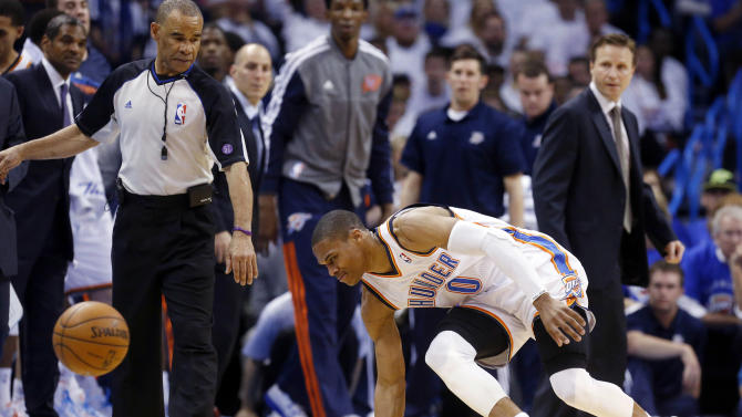 In this photo taken Wednesday, April 24, 2013, Oklahoma City Thunder guard Russell Westbrook stumbles after injuring his right knee in the second quarter of Game 2 of a first-round NBA basketball playoff series against the Houston Rockets in Oklahoma City. Westbrook, who remained in the game, will have surgery to repair a torn meniscus in his right knee and be out indefinitely, dealing a harsh blow to the City Thunder's championship chances. (AP Photo/Sue Ogrocki)