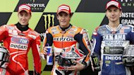 Honda&#39;s Marc Marquez (C) of Spain stands between Yamaha MotoGP rider Jorge Lorenzo (R) of Spain and Ducati MotoGP rider Andrea Dovizioso (L) of Italy after taking the pole position during the French Grand Prix in Le Mans circuit (Reuters)
