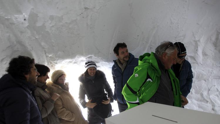 People wait to cast their votes for the primary elections to choose the Democratic Party's leader inside an igloo that is the highest polling station in Italy at 2,585m (8480 ft) above sea level on the Presena glacier