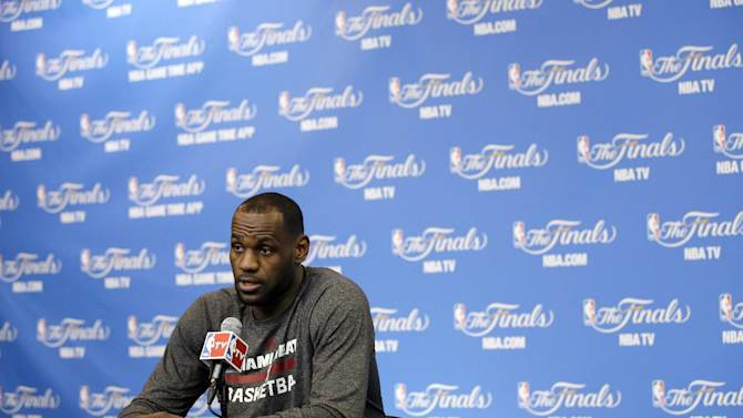 Miami Heat forward LeBron James answers a question during a news conference on Friday, June 6, 2014, in San Antonio. The team plays Game 2 of the NBA Finals against the San Antonio Spurs on Sunday