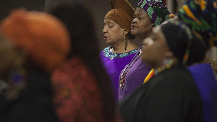 A traditional choir sings during a memorial service for the late Nelson Mandela at the Riverside Church in New York