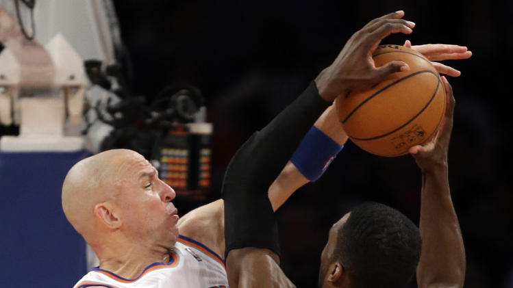 New York Knicks guard Jason Kidd (5) defends against a shot by Boston Celtics forward Jeff Green (8) in the first half of Game 5 of their first-round NBA basketball playoff series at Madison Square Garden in New York, Wednesday, May 1, 2013. (AP Photo/Kathy Willens)