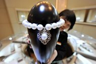 A Chinese jewellery store in Beijing displays a pearl necklace worth $160,000. The number of super-rich in Asia is set to reach 2.67 million people by 2015 with a net worth of an estimated $16.7 trillion, Swiss private bank Julius Baer said