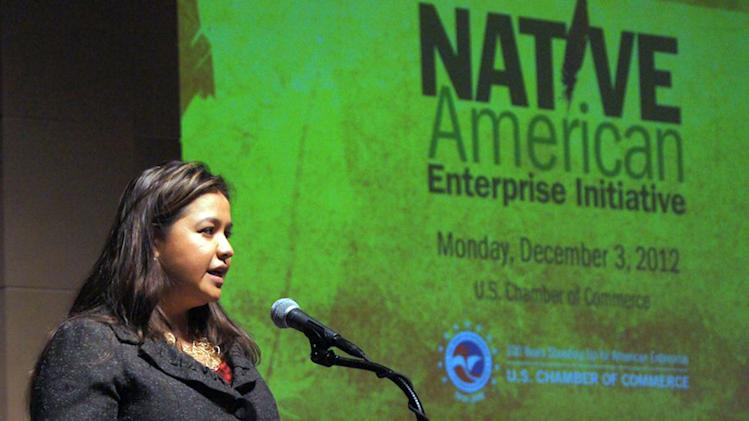 In this Dec. 3, 2012 photo provided by the Navajo Nation Washington Office, Navajo Nation executive director Clara Pratte addresses economic development during the Navajo Nation meeting of the Native American Enterprise Initiative, in Washington. When it comes to the automatic spending cuts that began taking effect this month, federal lawmakers spared from hard hits those programs that help the nation's most vulnerable, such as food stamps, Social Security and veterans' assistance. But that wasn't the case with programs serving American Indian reservations, where unemployment is far above the national average. Pratte said regardless of the outcome of the budget talks, tribal leaders should press Congress to make funding for Indian programs mandatory, not discretionary.  (AP Photo/Navajo Nation Washington Office, Jared King)