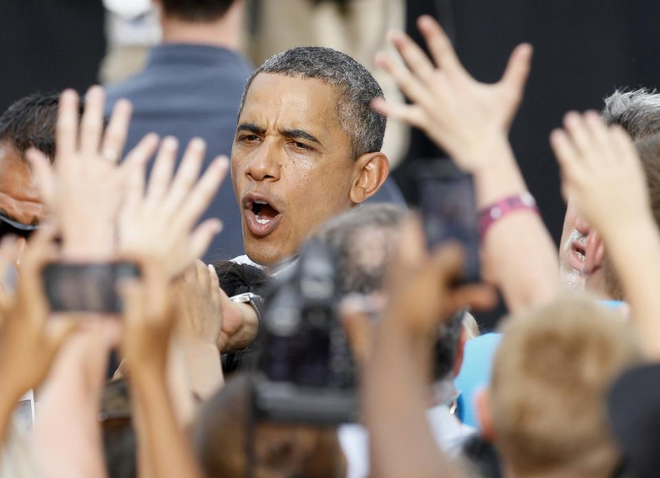 President Barack Obama works the crowd during a campaign stop Wednesday, Aug. 15, 2012, in Davenport, Iowa. (AP Photo/Charles Rex Arbogast)