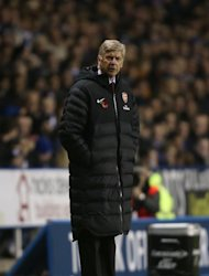 Arsene Wenger, pictured, wants to see Theo Walcott stay at Arsenal