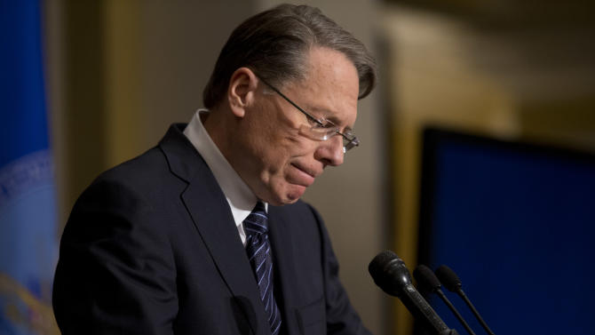 FILE - In this Dec. 21, 2012, file photo, The National Rifle Association executive vice president Wayne LaPierre, pauses as he speaks about the Newton, Conn., school shooting in Washington. In the weeks since Newtown, LaPierre has been the ever-present public face of gun rights forces, shuttling between speeches, hearing rooms and TV studios to forcefully reject proposals for tighter gun controls as misguided ideas that will do nothing to stop criminals and everything to tangle law-abiding citizens in a bureaucratic nightmare. (AP Photo/ Evan Vucci, File)