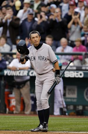 New York Yankees' Ichiro Suzuki doffs his batting helmet as fans cheer as he steps up to bat against the Seattle Mariners in the third inning of a baseball game Monday, July 23, 2012, in Seattle. The Mariners announced earlier in the day that Suzuki, who has played with the Mariners since 2001, was traded to the Yankees. (AP Photo/Elaine Thompson)