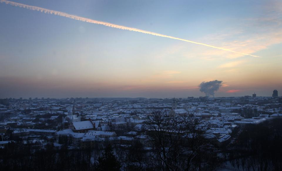 A view of the snow covered Vilnius during the sun sets over Vilnius , Lithuania, Monday, Feb. 6, 2012. The air temperature was -17 degrees Celsius (1,4 degrees Fahrenheit). (AP Photo/Mindaugas Kulbis) LITHUANIA OUT