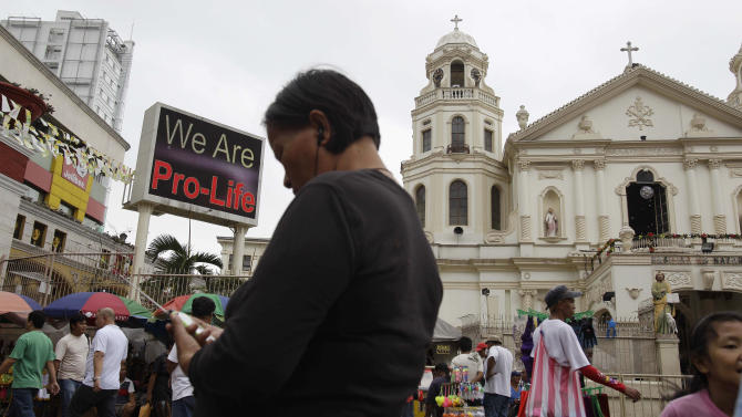 "A ""Pro-Life"" sign flashes on an electric signboard outside the Roman Catholic Minor Basilica of the Black Nazarene in downtown Manila, Philippines on Thursday, Jan. 3, 2013. Philippine President Benigno Aquino III last month signed the Responsible Parenthood and Reproductive Health Act of 2012. The law that provides state funding for contraceptives for the poor pitted the dominant Roman Catholic Church in an epic battle against the popular Aquino and his followers. (AP Photo/Aaron Favila)"