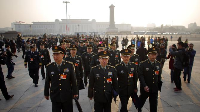 Military delegates arrive for the opening of the annual full session of the National People's Congress, the country's parliament, at Tiananmen Square in Beijing
