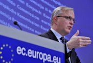 <p>EU commissioner on Economic and Monetary Affairs Olli Rehn gives a press conference in February 2012 at the EU Headquarters in Brussels. The European Union lifted on Friday a heavy financial penalty on Hungary after the country took steps to put its public finances in order.</p>