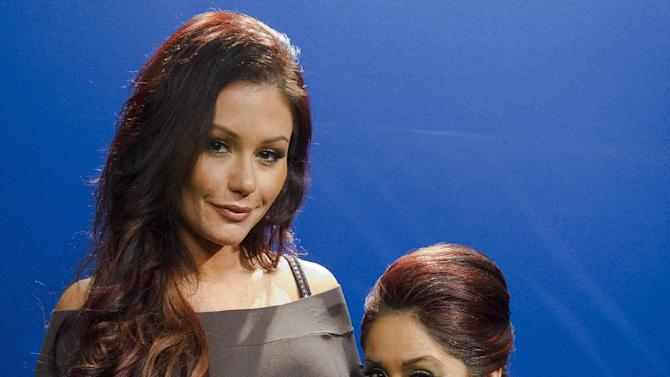 """FILE - This Feb. 1, 2012 file photo shows Jenni """"JWoww"""" Farley, left, and Nicole """"Snooki"""" Polizzi from the MTV series """"Jersey Shore,"""" pose for a portrait in New York. Polizzi is expecting her first child with fiance Jionni LaValle and is due in September. She said she was in her first trimester while filming her """"Jersey Shore"""" spin-off TV show with Jenni """"JWoww"""" Farley called """"Snooki and JWoww."""" (AP Photo/Charles Sykes, file)"""