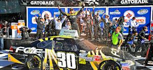 Buescher earns first victory in wreck-filled race