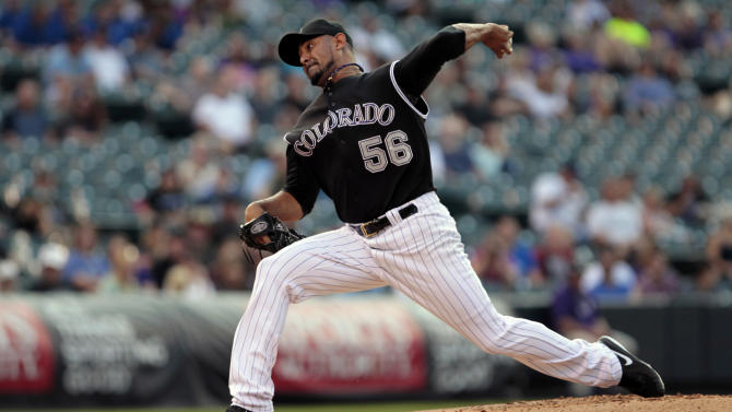 Morales helps Rockies to 2-1 win over Padres