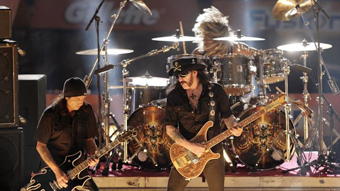 "FILE - In this Saturday, Oct. 7, 2006 file photo, rock band Motorhead performs during the show program of the the ""TV total Stock Car Crash Challenge 2006"" celebrities race at the Veltins-Arena in Gelsenkirchen, western Germany. While its critics often dismiss heavy metal as the music of the devil, it turns out the genre can actually be hazardous to your health. German doctors say they treated a man whose headbanging habit ultimately led to a brain injury, but they say the risk to fans is so small they shouldn't give up their rhythmic ways. Last January, Dr. Ariyan Pirayesh Islamian at Hannover Medical School saw a 50-year-old man who complained of constant, worsening headaches. The patient, who was not identified, had no history of head injuries or substance abuse problems but said he had been headbanging at a Motorhead concert with his son about one month before. After a computer scan, doctors realized their patient had a brain bleed and needed a hole drilled into his brain to drain the blood. The patient's headaches soon disappeared after the surgery. In a follow-up scan, his doctors saw he previously had a benign cyst which might have made the heavy metal aficionado more vulnerable to a brain injury. ""We are not against headbanging,"" Islamian said. ""The risk of injury is very, very low. But I think if (our patient) had (gone) to a classical concert, this would not have happened."" Motorhead is an English heavy metal band known for helping create the ""speed metal"" genre, which inspires extremely fast headbanging. Islamian described the band as ""one of the most hard-core rock and roll acts on earth."" (AP Photo/Martin Meissner, File)"