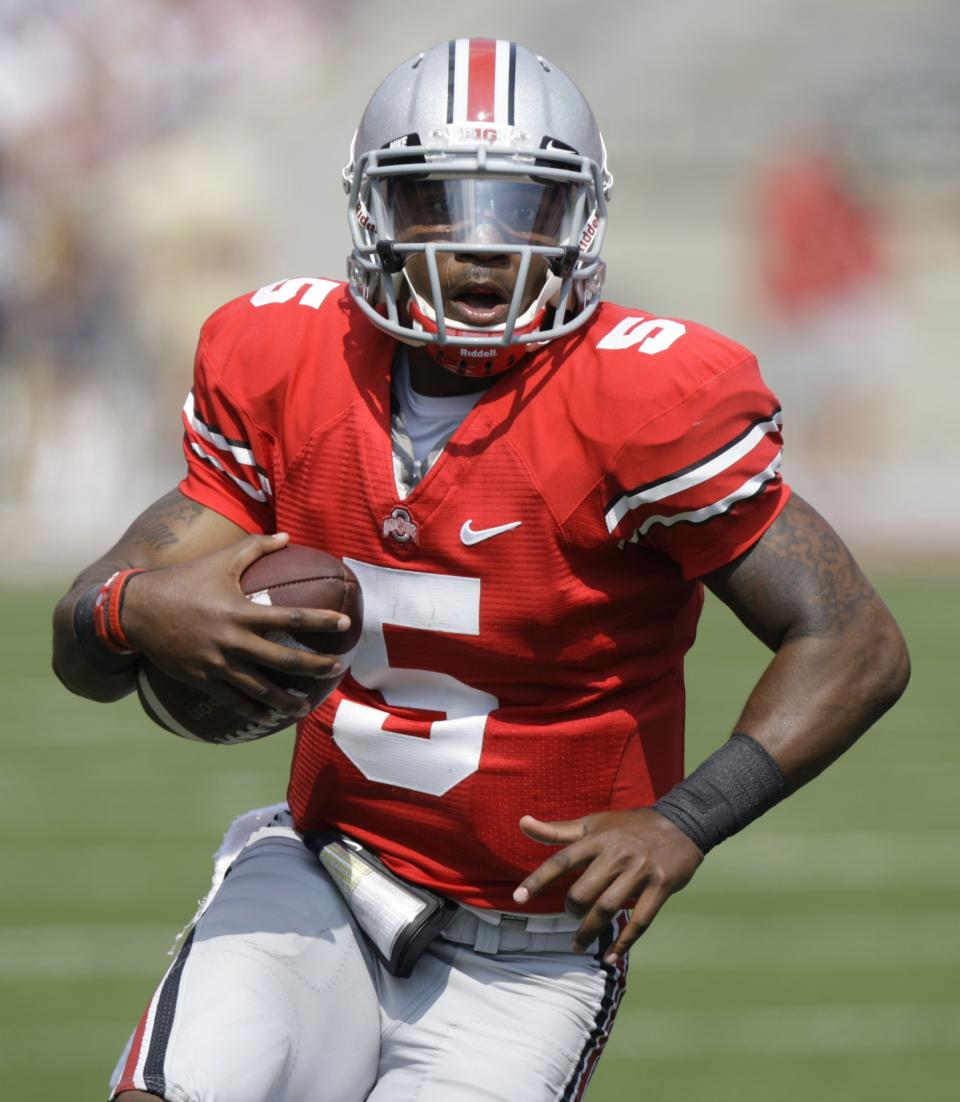 Ohio State quarterback Braxton Miller rolls out of the pocket during the third quarter against Akron in an NCAA college football game in Columbus, Ohio on Saturday, Sept. 3, 2011.  (AP Photo/Jay LaPrete)