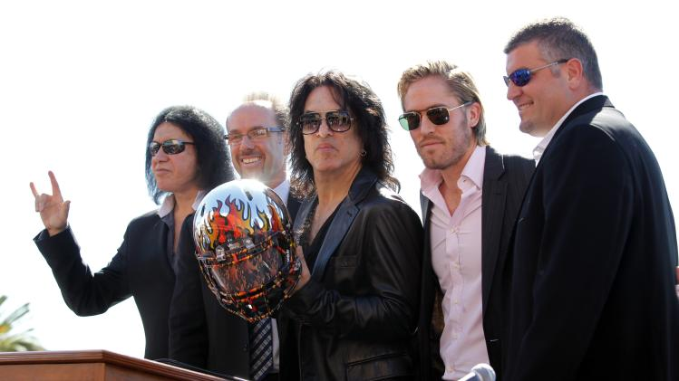 Musicians Simmons and Stanley of rock band KISS pose for photos with co-owner Bouchy, president Hoversten and head coach McMillen during a news conference to announce their part-ownership of Arena Football League team, the Los Angeles Kiss, in Anaheim