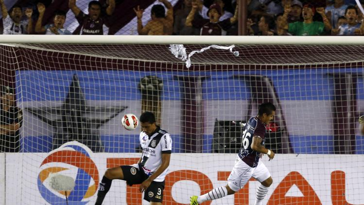 Ayala of Argentina's Lanus scores past Cesar of Brazil's Ponte Preta during their Copa Sudamericana second leg final soccer match in Buenos Aires