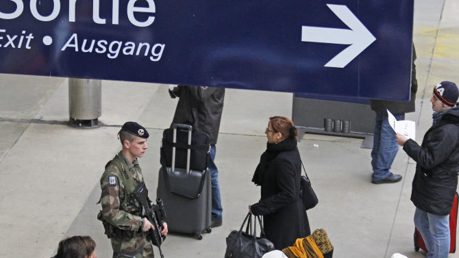 A French army soldier patrols Gare du Nord station in Paris, Monday Jan. 14, 2013. France has ordered tightened security in public buildings and transport following action against radical Islamists both in Mali and Somalia.(AP Photo/Remy de la Mauviniere)
