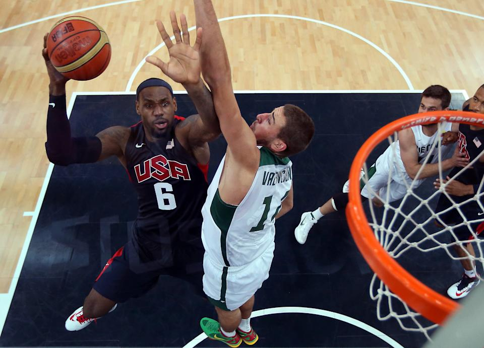 United States'  LeBron James (6) shoots against Lithuania during their men's preliminary round basketball game at the 2012 Summer Olympics on Saturday, Aug. 4, 2012, in London. (AP Photo/Christian Petersen, Pool)