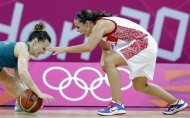 Australia's Jennifer Screen, left, and Russia's Becky Hammon, right, chase a loose ball during a preliminary women's basketball game at the 2012 Summer Olympics, Friday, Aug. 3, 2012, in London. (AP Photo/Eric Gay)