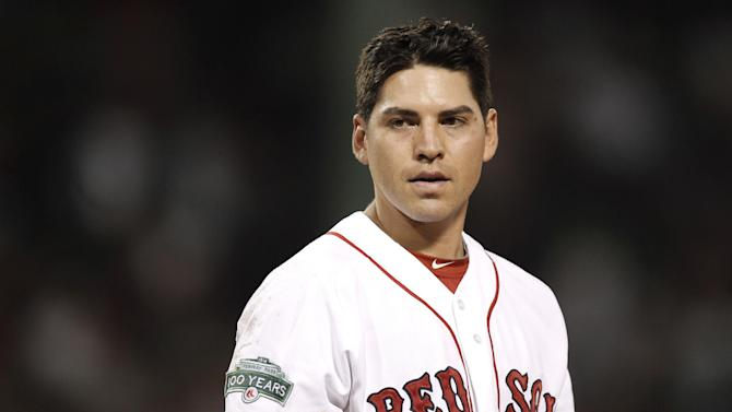 In this August 2012, photo, Boston Red Sox's Jacoby Ellsbury pauses during the Red Sox's baseball game against the Detroit Tigers at Fenway Park in Boston. Ellsbury and the Red Sox agreed to a $9 million contract on Friday, Jan. 18, 2013. (AP Photo/Winslow Townson)