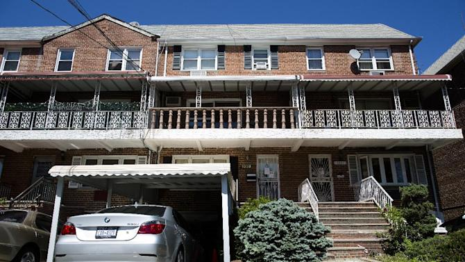 The home of a 10-year-old Brooklyn boy who police say on Monday picked up a gun dropped by a would-be robber dressed as a delivery man and fired a shot, is seen Tuesday, June 4, 2013, in New York. No injuries were reported. (AP Photo/John Minchillo)