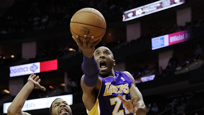 Los Angeles Lakers' Kobe Bryant (24) shoots against Houston Rockets' Marcus Morris (2) in the first half of an NBA basketball game, Tuesday, Dec. 4, 2012, in Houston. (AP Photo/Pat Sullivan)
