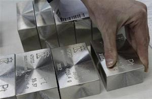 An employee sets out and sorts ingots of 99.97 percent pure platinum at the Krastsvetmet nonferrous metals plant in Russia's Siberian city of Krasnoyarsk