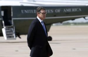 Texas Governor Perry awaits the arrival of U.S. President Obama in Dallas