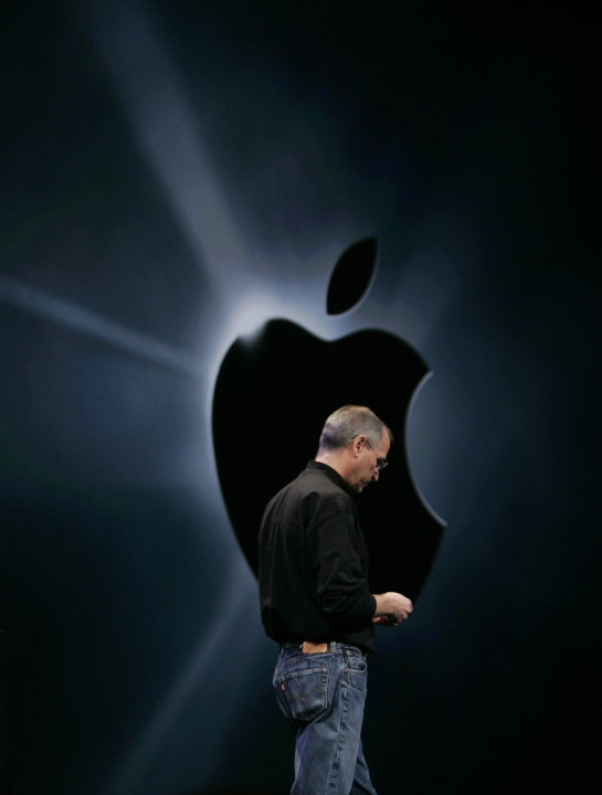 FILE - In this Jan. 9, 2007 file photo, Apple CEO Steve Jobs unveils the new AppleTV and iPhone during his keynote address at MacWorld Conference & Expo in San Francisco. Apple Inc. on Wednesday, Aug.